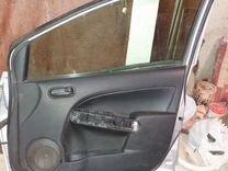 Водительская дверь Mazda Demio III (DE)